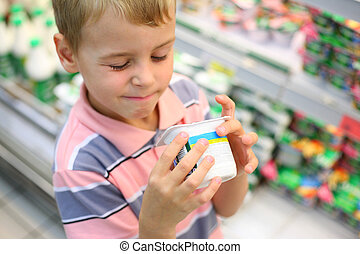 Boy in shop with yoghurt
