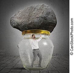 Man trapped in a jar with rock