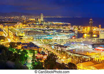 Aerial view Barcelona at night, Catalonia, Spain - Aerial...