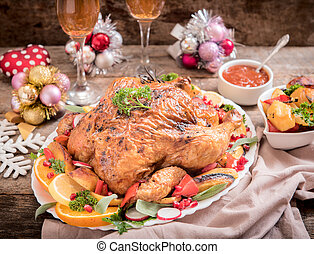 Holidays dinner - Winter holidays concept with split roasted...