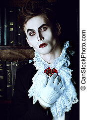 Dracula - Handsome vampire nobleman studying ancient books...