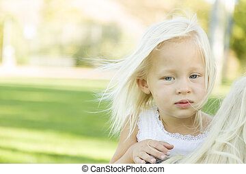 Meloncholy Portrait of Cute Little Girl Outside in Park