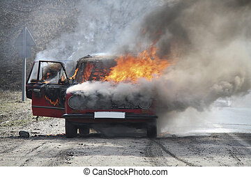 Burning car on desert rural road