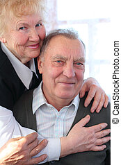 Portrait of elderly pair looking at camera