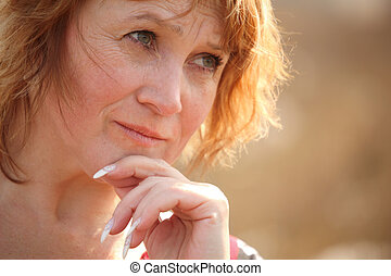 Thinking middleaged woman