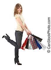 Happy blonde with paper bags full body