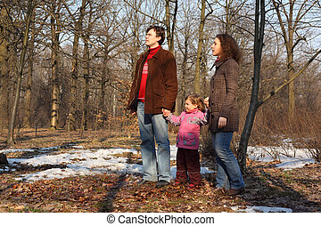 Family in spring wood - Family with daughter in spring wood...