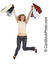 Happy dancing  blonde holds paper bags in rised hands