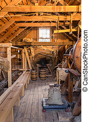 Inside grist mill - Inside an old vintage wooden grist mill.