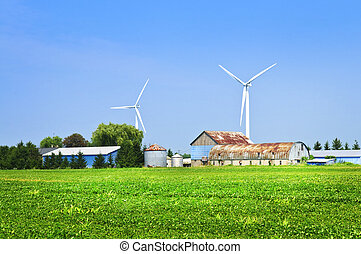 Wind turbines on farm - Green alternative clean power wind...