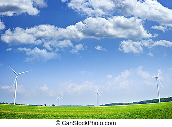 Wind turbines in field