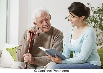 Yong carer reading book - Image of young carer reading book...