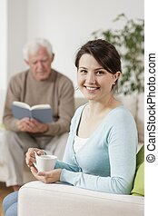 Smiling carer and old man - Image of smiling carer and old...