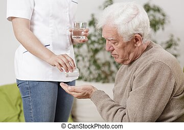 Private nurse giving medicines - Photo of private nurse...