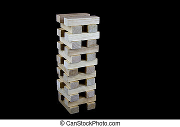 Wooden Play Blocks Stacked Against a Black Background -...
