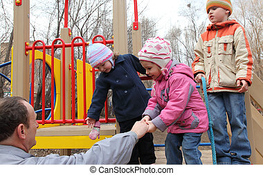elderly man with children on playground