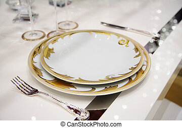table with dinner dishes - table with dinner service