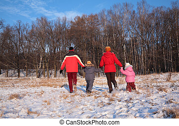 Family run from back in wood in winter