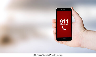 911 phone on user´s hand - safety concept: 911 sign on...