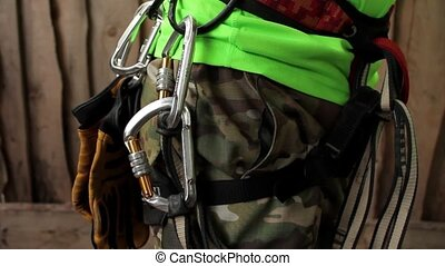 climbing equipment on the belt - climbing equipment hanging...
