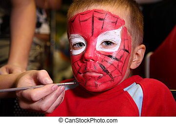 boy painted as spiderman - boy face painted as hero
