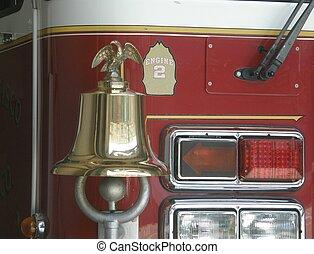 Fire engine - Classic brass bell on modern fire engine