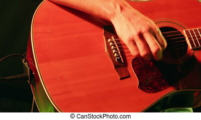 Acoustic guitar at concert - Musician concert playing an...