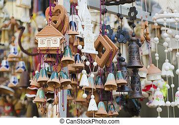 Souvenir bells at the market - Souvenir ceramic bells and...