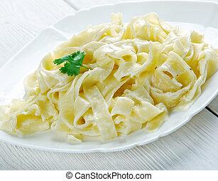 pasta Fettuccine Alfredo with cream close up