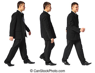 young smiling businessman walks - three young smiling...