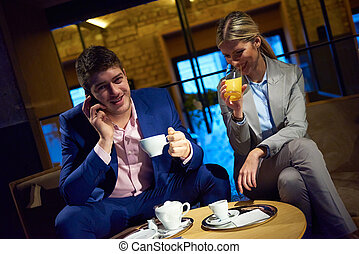 business couple take drink after work - young business...