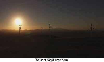 Wind turbines aerial view at sunset, backlight - Aerial view...