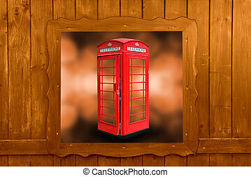 Classic British red phone booth in London UK, wooden window,...