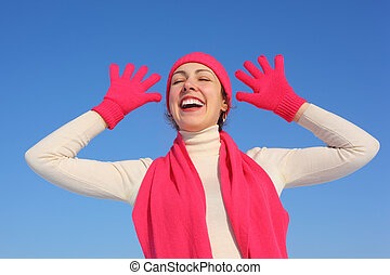 Young woman in red gloves