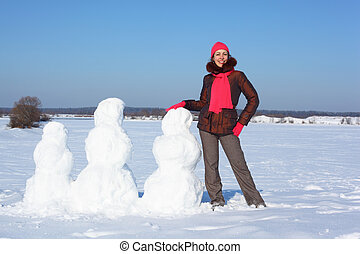 Young beauty woman and three snowmans
