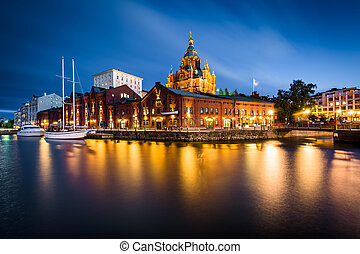 View of the island of Katajanokka and Uspenski Cathedral at night, in Helsinki, Finland.