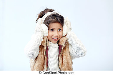 happy little girl wearing earmuffs - winter, people,...