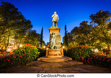 Statue of Johan Ludwig Runeberg at Esplanadi Park at night, in Helsinki, Finland.