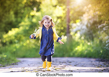 Little girl in nature - Cute little girl outside in nature...