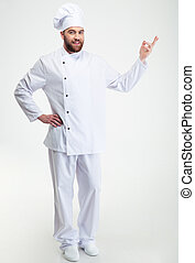 Happy chef cook showing welcome gesture - Full length...