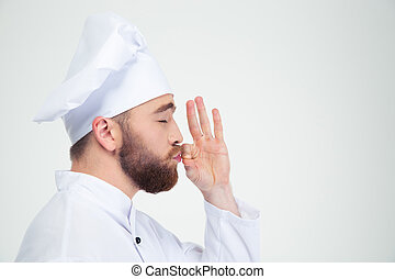 Male chef cook smelling something in fingers - Portrait of a...