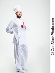 Handsome male chef cook showing thumb up sign - Full length...