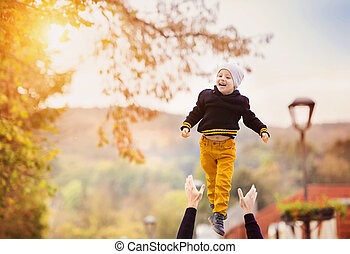 Happy family in a city park - Father with his son on a walk...