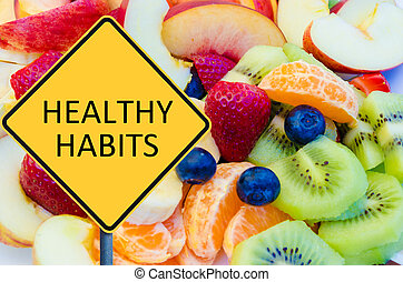 Yellow roadsign with message HEALTHY HABITS over background...