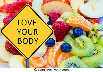 Yellow roadsign with message LOVE YOUR BODY over background...
