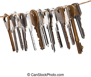 Keys on the thread  over white background