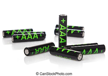 Heap of AAA batteries on white background