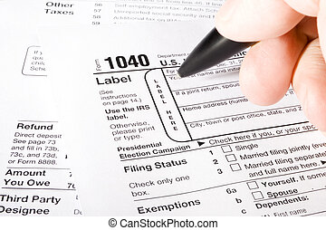 1040 Tax Form - Stock image of man filling out 1040 Tax form