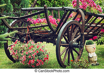 Wooden cart with summer flowers - Wooden garden wagon with...