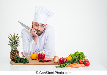 Portrait of a young chef cook preparing food